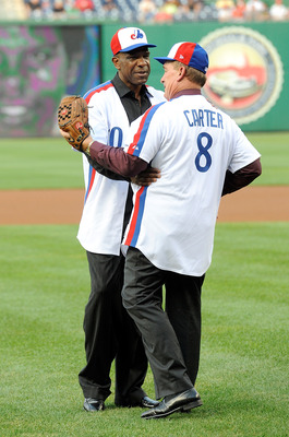 WASHINGTON - AUGUST 10:  Andre Dawson #10 embraces Gary Carter #8 after throwing out the first pitch before the game between the Washington Nationals and the Florida Marlins at Nationals Park on August 10, 2010 in Washington, DC.  (Photo by Greg Fiume/Get