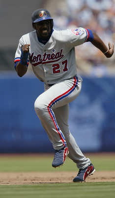 LOS ANGELES - AUGUST 21:  Right fielder Vladimir Guerrero #27 of the Montreal Expos runs to base during the game against the Los Angeles Dodgers on August 21, 2003 at Dodger Stadium in Los Angeles, California. The Dodgers defeated Expos 2-1. (Photo by Jef