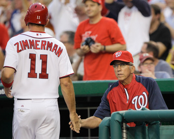 WASHINGTON, DC - JULY 07: Manager Davey Johnson #5 congratulates Ryan Zimmerman #11 of the Washington Nationals after he scored during the third inning against the Chicago Cubs at Nationals Park on July 7, 2011 in Washington, DC.  (Photo by Rob Carr/Getty