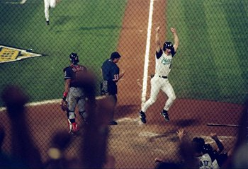 26 Oct 1997:  Pitcher Craig Counsell of the Florida Marlins celebrate after scoring the winning run on an Edgar Renteria RBI single to defeat the Cleveland Indians 3-2 after 11 innings during Game 7 of the 1997 World Series at Pro Player Stadium in Miami,