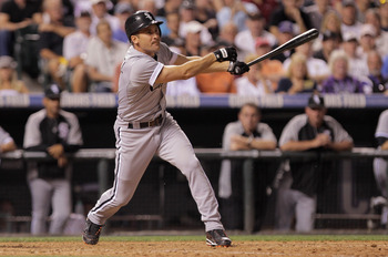DENVER, CO - JUNE 28:  Omar Vizquel #11 of the Chicago White Sox takes an at bat agaisnt the Colorado Rockies during Interleague play at Coors Field on June 28, 2011 in Denver, Colorado. The Rockies defeated the White Sox 3-2 in 13 innings.  (Photo by Dou