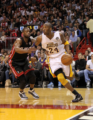 MIAMI, FL - MARCH 10:  Kobe Bryant #24 of the Los Angeles Lakers drives past Dwyane Wade #3 of the Miami Heat during a game at American Airlines Arena on March 10, 2011 in Miami, Florida. NOTE TO USER: User expressly acknowledges and agrees that, by downl