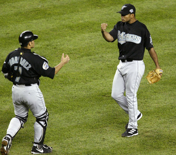 BRONX, NY - OCTOBER 18:  Catcher Ivan Rodriguez #7 and pitcher Ugueth Urbina #74 of the Florida Marlins celebrate their 3-2 win over the New York Yankees during game one of the Major League Baseball World Series October 18, 2003 at Yankee Stadium in the B