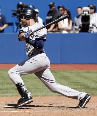 TORONTO, CANADA - JULY 16: Derek Jeter #2 of the New York Yankees hits against the Toronto Blue Jays during MLB action at The Rogers Centre July 16, 2011 in Toronto, Ontario, Canada. (Photo by Abelimages/Getty Images)