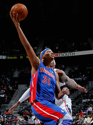 ATLANTA - NOVEMBER 03:  Charlie Villanueva #31 of the Detroit Pistons drives to the basket against Josh Smith #5 of the Atlanta Hawks at Philips Arena on November 3, 2010 in Atlanta, Georgia.  NOTE TO USER: User expressly acknowledges and agrees that, by