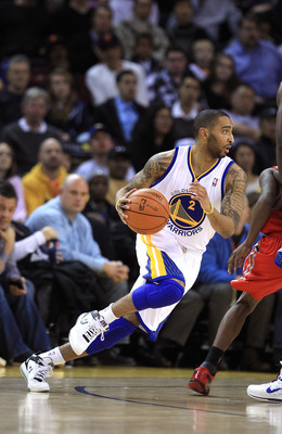 OAKLAND, CA - DECEMBER 20:  Acie Law #2 of the Golden State Warriors in action against the Houston Rockets at Oracle Arena on December 20, 2010 in Oakland, California. NOTE TO USER: User expressly acknowledges and agrees that, by downloading and or using