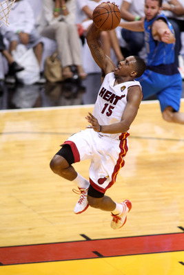 MIAMI, FL - JUNE 12:  Mario Chalmers #15 of the Miami Heat drives for a shot attempt against the Dallas Mavericks in Game Six of the 2011 NBA Finals at American Airlines Arena on June 12, 2011 in Miami, Florida. NOTE TO USER: User expressly acknowledges a