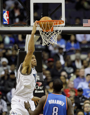 WASHINGTON, DC - MARCH 14:  JaVale McGee #34 of the Washington Wizards dunks against Nazr Mohammed #8 of the Oklahoma City ThundeOklahoma City Thunderduring the first half at the Verizon Center on March 14, 2011 in Washington, DC. NOTE TO USER: User expre