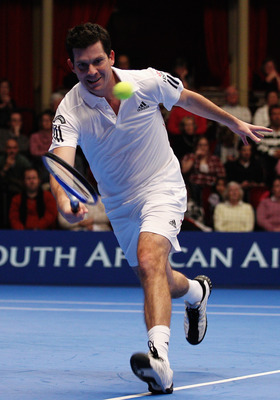 LONDON, ENGLAND - DECEMBER 03:  Tim Henman of Great Britain in action during the quarter final match between Thomas Enqvist and Tim Henman on day four of the AEGON Masters 2010 at the Royal Albert Hall on December 3, 2010 in London, England.  (Photo by Pa