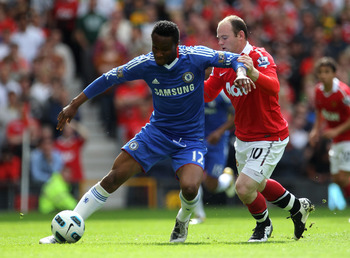 MANCHESTER, ENGLAND - MAY 08:  John Obi Mikel of Chelsea is challenged by Wayne Rooney of Manchester United during the Barclays Premier League match between Manchester United and Chelsea at Old Trafford on May 8, 2011 in Manchester, England.  (Photo by Al