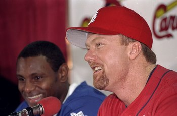 7 Sep 1998:  Mark McGwire #25 of the St. Louis Cardinals and Sammy Sosa #21 of the Chicago Cubs answer questions from the media during McGwire''s 61st home run of the season press conference at Busch Stadium in St. Louis, Missouri. The Cardinals defeated