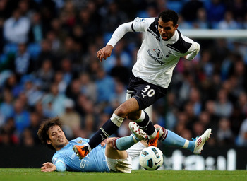 MANCHESTER, ENGLAND - MAY 10:  Sandro of Tottenham Hotspur competes with David Silva of Manchester City during the Barclays Premier League match between Manchester City and Tottenham Hotspur at the City of Manchester Stadium on May 10, 2011 in Manchester,