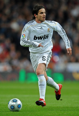 MADRID, SPAIN - NOVEMBER 10:  Fernando Gago of Real Madrid runs with the ball during the Copa del Rey fourth round, second leg match between Real Madrid and AD Alcorcon at the Estadio Santiago Bernabeu on November 10, 2009 in Madrid, Spain. Real Madrid wo