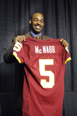 ASHURN, VA - APRIL 6:  Donovan McNabb of the Washington Redskins displays his new jersey during a press conference on April 6, 2010 at Redskin Park in Ashburn, Virginia.  (Photo by Mitchell Layton/Getty Images)