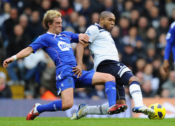 LONDON, ENGLAND - FEBRUARY 05:  Stuart Holden of Bolton Wanderers and Wilson Palacios of Tottenham Hotspur battle for the ball during the Barclays Premier League match between Tottenham Hotspur and Bolton Wanderers at White Hart Lane on February 5, 2011 i