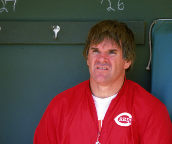 SAN DIEGO, CA - 1986:  Pete Rose #14 of the Cincinnati Reds sits in the dugout prior to the game against the San Diego Padres at Jack Murphy Stadium during the 1986 MLB season in San Diego, California.  (Photo by Stephen Dunn/Getty Images)