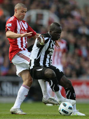 STOKE ON TRENT, ENGLAND - MARCH 19:  Jonathan Walters of Stoke City challenges Cheik Tiote of Newcastle United during the Barclays Premier League match between Stoke City and Newcastle United at Britannia Stadium on March 19, 2011 in Stoke on Trent, Engla