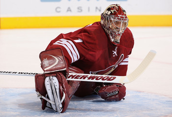 GLENDALE, AZ - FEBRUARY 02:  Goaltender Jason LaBarbera #1 of the Phoenix Coyotes stretches during the NHL game against the Vancouver Canucks at Jobing.com Arena on February 2, 2011 in Glendale, Arizona. The Canucks defeated the Coyotes 6-0.   (Photo by C