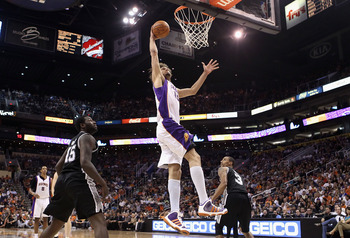 PHOENIX, AZ - APRIL 13:  Robin Lopez #15 of the Phoenix Suns slam dunks the ball against the San Antonio Spurs during the NBA game at US Airways Center on April 13, 2011 in Phoenix, Arizona.  NOTE TO USER: User expressly acknowledges and agrees that, by d