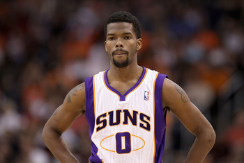 PHOENIX, AZ - MARCH 30:  Aaron Brooks #0 of the Phoenix Suns during the NBA game against the Oklahoma City Thunder at US Airways Center on March 30, 2011 in Phoenix, Arizona.  The Thunder defeated the Suns 116-98. NOTE TO USER: User expressly acknowledges