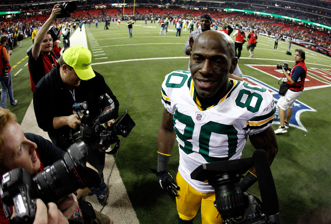 ATLANTA, GA - JANUARY 15:  Donald Driver #80 of the Green Bay Packers celebrates as he walks off the field after the Packers own 48-21 against the Atlanta Falcons during their 2011 NFC divisional playoff game at Georgia Dome on January 15, 2011 in Atlanta