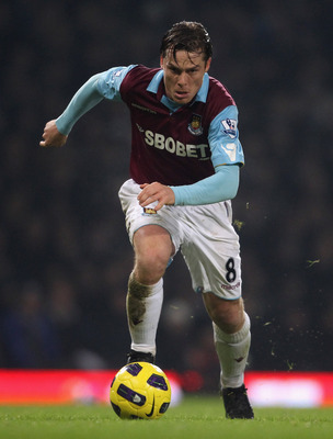 LONDON, ENGLAND - DECEMBER 28:  Scott Parker of West Ham United runs with the ball during the Barclays Premier League match between West Ham United and Everton at the Boleyn Ground on December 28, 2010 in London, England.  (Photo by Scott Heavey/Getty Ima