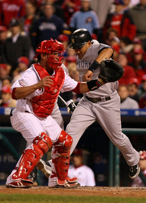 PHILADELPHIA - NOVEMBER 01:  Melky Cabrera #53 of the New York Yankees scores on a RBI single by Johnny Damon #18 in the top of the fifth inning against catcher Carlos Ruiz #51 of the Philadelphia Phillies in Game Four of the 2009 MLB World Series at Citi