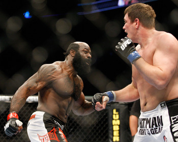 MONTREAL- MAY 8: Kimbo Slice (L) punches Matt Mitrione in their heavyweight bout at UFC 113 at Bell Centre on May 8, 2010 in Montreal, Quebec, Canada.  (Photo by Richard Wolowicz/Getty Images)