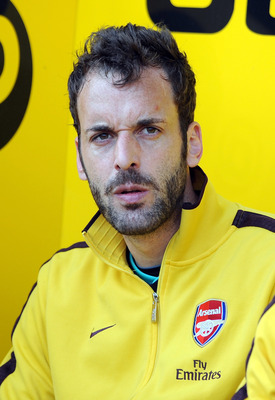 BLACKPOOL, ENGLAND - APRIL 10: Manuel Almunia of Arsenal looks on from the substitute's bench during the Barclays Premier League match between Blackpool and Arsenal at Bloomfield Road on April 10, 2011 in Blackpool, England.  (Photo by Chris Brunskill/Get