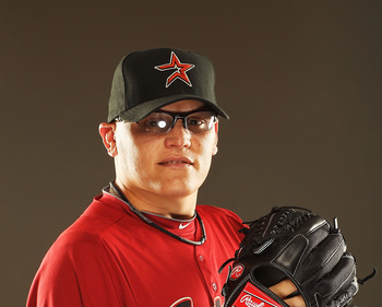 KISSIMMEE, FL - FEBRUARY 24:  Gustavo Chacin #27 of the Houston Astros poses for a portrait during Spring Training photo Day at Osceola County Stadium  on February 24, 2011 in Kissimmee, Florida.  (Photo by Al Bello/Getty Images)