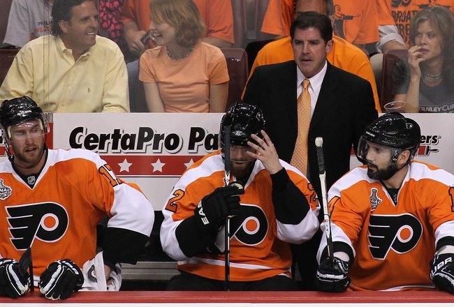 PHILADELPHIA - JUNE 02:  Head coach Peter Laviolette of the Philadelphia Flyers looks on from the bench in Game Three of the 2010 NHL Stanley Cup Final against the Chicago Blackhawks at Wachovia Center on June 2, 2010 in Philadelphia, Pennsylvania.  (Phot