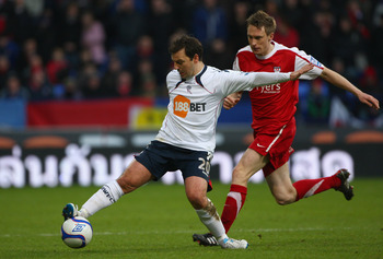 BOLTON, ENGLAND - JANUARY 08: Robbie Blake of Bolton Wanderers in action with Daniel Parslow of York City during the F.A Cup sponsored by E.ON 3rd round match between Bolton Wanderers and York City at Reebok Stadium on January 8, 2011 in Bolton, England.
