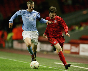 LIVERPOOL, UNITED KINGDOM - APRIL 13:  Michael Johnson of Man City holds off Paul Barratt of Liverpool during the FA Youth Cup Final 1st Leg match between Liverpool and Manchester City at Anfield on April 13, 2006 in Liverpool, England.  (Photo by Richard
