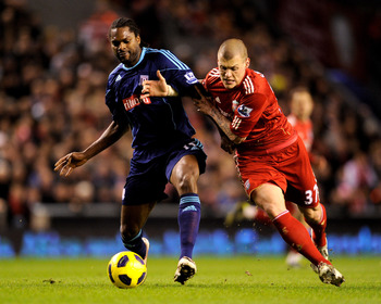 LIVERPOOL, ENGLAND - FEBRUARY 02:  Martin Skrtel of Liverpool tussles for posession with Salif Diao of Stoke City during the Barclays Premier League match between Liverpool and Stoke City at Anfield on February 2, 2011 in Liverpool, England.  (Photo by Mi