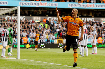 WOLVERHAMPTON, ENGLAND - MAY 08:  Adlene Guedioura of Wolves celebrates after scoring their second goal during the Barclays Premier League match between Wolverhampton Wanderers and West Bromwich Albion at Molineux on May 8, 2011 in Wolverhampton, England.