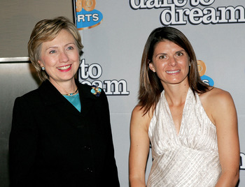 NEW YORK - NOVEMBER 29:  Member of the gold medal winning U.S. Women's National Team at the 1996 Olympic Games, Mia Hamm (R), poses for a photo with Senator Hillary Rodham Clinton as they attend the HBO Sports Premiere of 'Dare to Dream' at Loews Cineplex