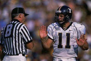 8 Sep 2001:  Quarterback Brandon Doman #11 of the Brigham Young Cougars talking with the referee during the game against the California Bears at Memorial Stadium in Berkeley, California. The Cougars defeated the Bears 44-16.Mandatory Credit: Jed Jacobsohn