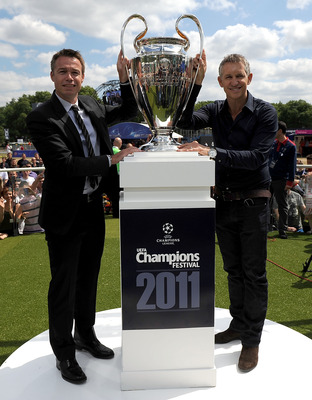 LONDON, ENGLAND - MAY 21:  Gary Lineker and Graeme Le Saux pose next to the UEFA Champions League Trophy during the Opening of the UEFA Champions League Festival in Hyde Park on May 21, 2011 in London, England.  (Photo by Christopher Lee/Getty Images for