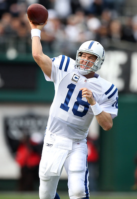 OAKLAND, CA - DECEMBER 26:  Peyton Manning #18 of the Indianapolis Colts passes against the Oakland Raiders during an NFL game at Oakland-Alameda County Coliseum on December  26, 2010 in Oakland, California.  (Photo by Jed Jacobsohn/Getty Images)