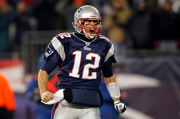 FOXBORO, MA - DECEMBER 06:  Tom Brady #12 of the New England Patriots reacts after BenJarvus Green-Ellis scored a 1-yard rushing touchdown in the first quarter against the New York Jets at Gillette Stadium on December 6, 2010 in Foxboro, Massachusetts.  (