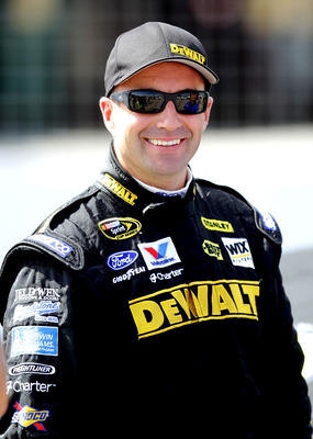 LOUDON, NH - JULY 15:  Marcos Ambrose, driver of the #9 Dewalt Ford, walks on the grid during qualifying for the NASCAR Sprint Cup Series LENOX Industrial Tools 301 at New Hampshire Motor Speedway on July 15, 2011 in Loudon, New Hampshire.  (Photo by Jerr