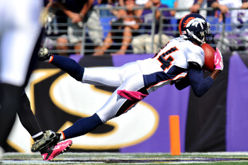 BALTIMORE, MD - OCTOBER 10:  Brandon Lloyd #84 of the Denver Broncos scores a touchdown against the Baltimore Ravens at M&T Bank Stadium on October 10, 2010 in Baltimore, Maryland. Players wore pink in recognition of Breast Cancer Awareness Month. The Rav