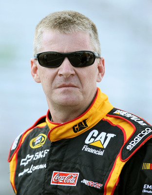 LOUDON, NH - JULY 15:  Jeff Burton, driver of the #31 Caterpillar Chevrolet, stands next to his car during qualifying for the NASCAR Sprint Cup Series LENOX Industrial Tools 301 at New Hampshire Motor Speedway on July 15, 2011 in Loudon, New Hampshire.  (
