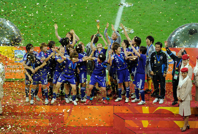 FRANKFURT AM MAIN, GERMANY - JULY 17:  The team of Japan celebrates after winning the FIFA Womens's World Cup Final between the United States of America and Japan at FIFA Word Cup stadium on July 17, 2011 in Frankfurt am Main, Germany.  (Photo by Thorsten