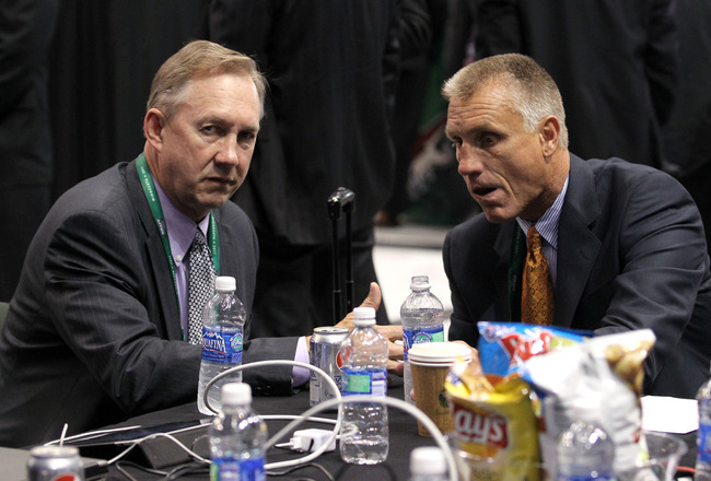 ST PAUL, MN - JUNE 24:  Assistant General Manager John Paddock and General Manager Paul Holmgren of the Philadelphia Flyers during day one of the 2011 NHL Entry Draft at Xcel Energy Center on June 24, 2011 in St Paul, Minnesota.  (Photo by Bruce Bennett/G