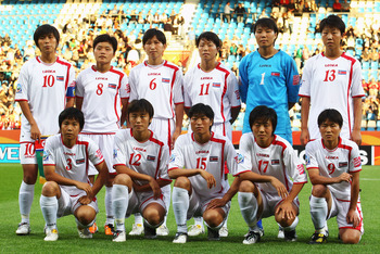 BOCHUM, GERMANY - JULY 06: The team of Korea DPR is pictured prior to the FIFA Women's World Cup 2011 Group C match between Korea DPR and Colombia at Rewirpower Stadium on July 6, 2011 in Bochum, Germany.  (Photo by Joern Pollex/Getty Images)