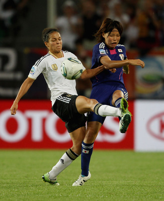 WOLFSBURG, GERMANY - JULY 09:  Celia Okoyino Da Mbabi of Germany (L) in action with Kozue Ando of Japan during the FIFA Women's World Cup 2011 Quarter Final match between Germany and Japan at Wolfsburg Area on July 9, 2011 in Wolfsburg, Germany.  (Photo b