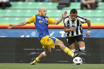 UDINE, ITALY - APRIL 23: Alexis Sanchez of Udinese Calcio fights for the ball with Francesco Valiani of Parma FC during the Serie A match between Udinese Calcio and Parma FC at Stadio Friuli on April 23, 2011 in Udine, Italy.  (Photo by Gabriele Maltinti/
