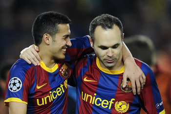 BARCELONA, SPAIN - MAY 03:  Pedro Rodriguez (L) and Andres Iniesta of FC Barcelona celebrate after defeating Real Madrid at the end of the UEFA Champions League Semi Final second leg match between Barcelona and Real Madrid at the Camp Nou on May 3, 2011 i