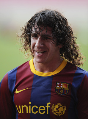 BARCELONA, SPAIN - MAY 23: Carles Puyol of FC Barcelona looks on during the FC Barcelona training session held ahead of next saturday UEFA Champions League Final at the Camp Nou Stadium on May 23, 2011 in Barcelona, Spain.  (Photo by David Ramos/Getty Ima